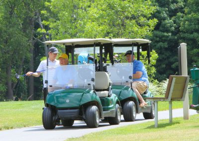 Golf carts and golfers
