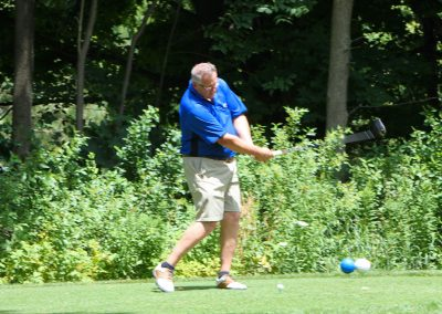 Coach Tom teeing off hole