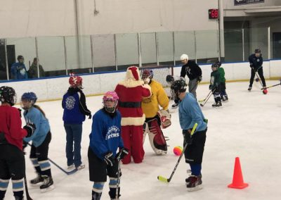 Santa talking to goalie